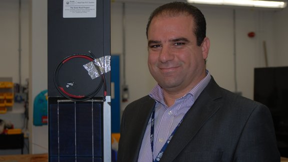 Dr Hussam Jouhara  with the solar technology. Image: Brunel
