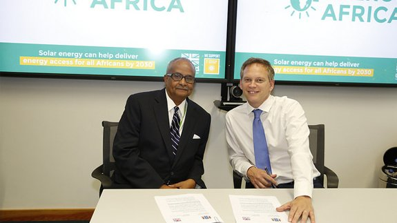 International Development Minister Grant Shapps signs partnership agreements at the launch of the Energy Africa campaign. Image: Department for International Development