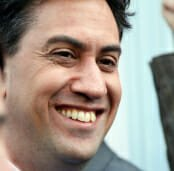 Special Report: Energy price cap Ed Milliband smiling on a photograph.