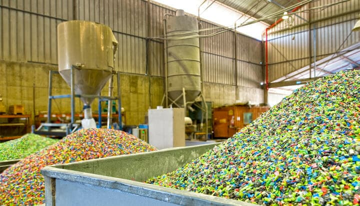 Picture of a facility with plastics ready to be recycled.