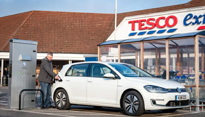 VW Golf charging in a Tesco car park