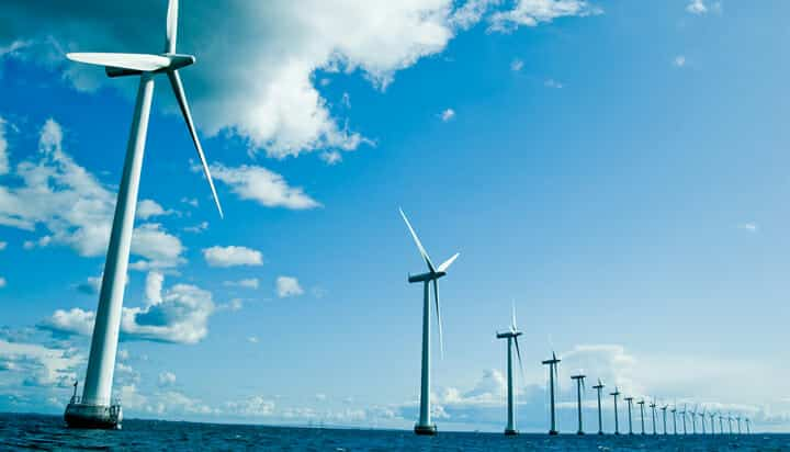 Picture of offshore wind turbines with the blue sky and clouds