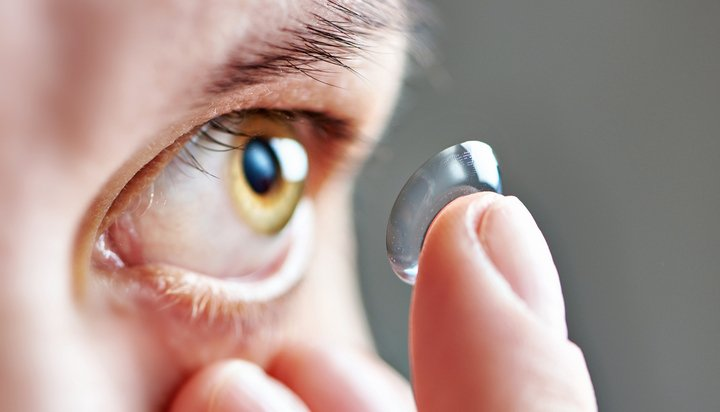 Contact lens being placed in eye