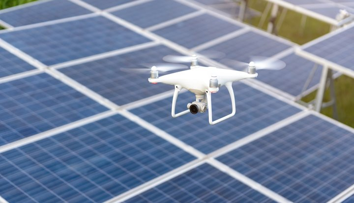 Drone flying over solar panels