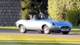 Prince Harry and Meghan Markle make a royal arrival in electric Jag